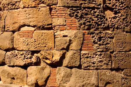 Roman wall in the city of Barcelona. Background picture photo