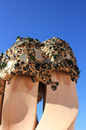 On the terrace of the Casa Mila (also called La Pedrera) is a cross-shaped chimneys and soldiers of anthropomorphic forms created by Antonio Gaudi. Stock Photo - 6964901
