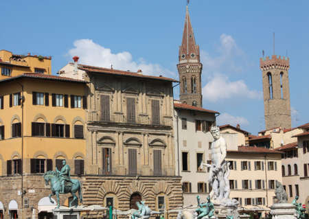 seniority: Overview of Piazza della Signoria (Florence, Tuscany, Italy), with several monuments: the fountain of Neptune and equestrian statue of Cosimo I.