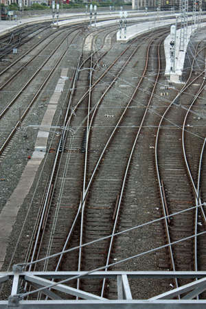 crossings: Railroad tracks and catenary, with crossings of roads and sidewalks. Bilbao, Spain.