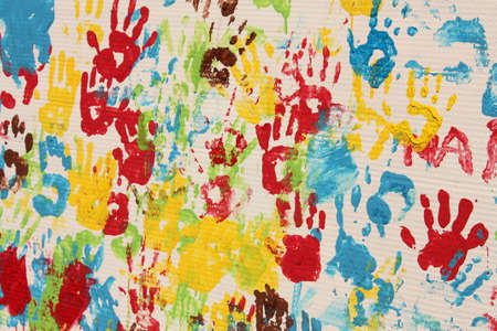 spontaneous painting: Handprints in different colors in a mural. Background picture. Stock Photo