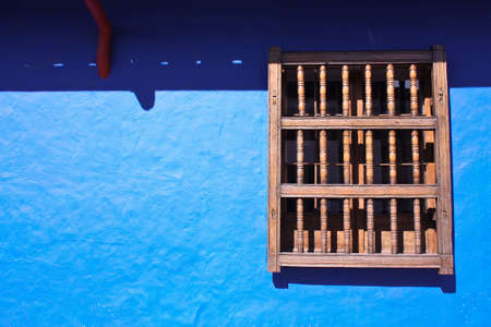 window and wal in blue. House in the spanish colonial neighborhood of La Candelaria, Bogota, Colombia photo