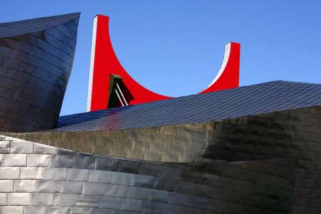 futurism: Detail of the facade of titanium the Guggenheim Museum, and La Salve bridge. Bilbao, Euskadi, Spain Stock Photo