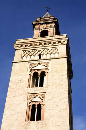 marcos: Tower of the Church of San Marcos, Seville, Andalucia, Spain. Ferdinand Temple built on an ancient mosque, one of the Gothic-Mudejar of the city Stock Photo