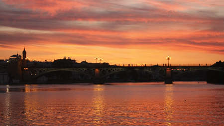 andalucia: Dusk in the Guadalquivir. Triana Bridge, Seville, Andalucia, Spain