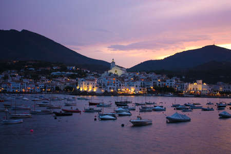 Cadaques sunset. Romanticism in the Mediterranean Sea. The village of Salvador Dali, in Costa Brava, Gerona, Catalonia, Spain.  photo