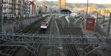 Railroad tracks and catenary, with crossings of roads and sidewalks. Bilbao, Spain. Stock Photo - 7855938