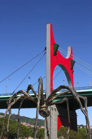 La Salve bridge, the gateway to the city of Bilbao, and The giant spider  photo