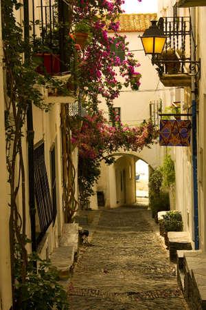 spain: Dawn. Narrow street in a small Mediterranean village. Cadaques, Costa Brava, Catalonia, Spain