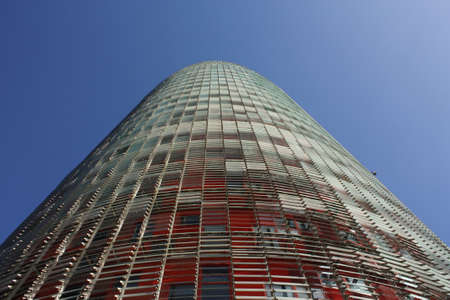 Skyscrapers in conical shape, playing with colors and lights. New Symbol of the city of Barcelona, Spain.  BARCELONA, FEB 2. Facade of Agbar Tower on Feb 2, 2010 in Barcelona, Spain. The Torre Agbar is a new skyscraper in a conical shape, which has become