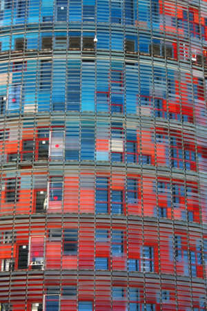 Skyscrapers in conical shape, playing with colors and lights. New Symbol of the city of Barcelona, Spain  BARCELONA, FEB 2. Facade of Agbar Tower on Feb 2, 2010 in Barcelona, Spain. The Torre Agbar is a new skyscraper in a conical shape, which has become