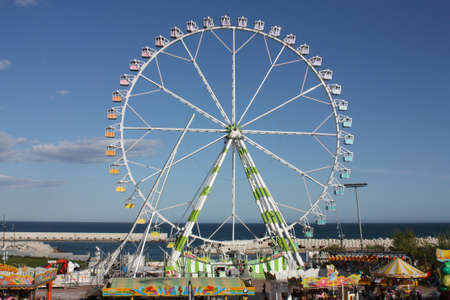 Ferris wheel in the amusement park of the Feria de Abril, a seashore, Barcelona, Catalonia, Spain.  Photo taken on: Apr 27, 2009 Stock Photo - 8822168