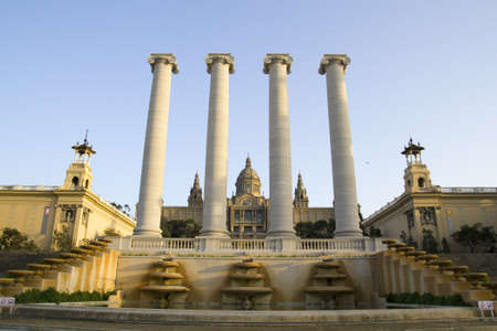 an exposition: Barcelona, Spain - March 9, 2011 - National Palace of Barcelona, with the four pillars that symbolize the Catalan flag. Built following the International Exposition of 1929, held in the mountain of Montjuic. Today is National Museum of Catalan Art, MNAC.
