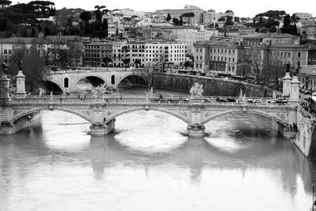 ancient buildings: Tiber river. Vittorio Emanuele bridge. Monochrome photography. Stock Photo
