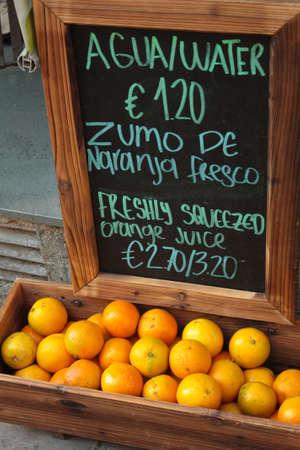 alimentation: Trade orange juice in Barcelona and blackboard