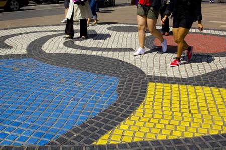 the ramblas: Colored pavement and people walking on the Ramblas of Barcelona