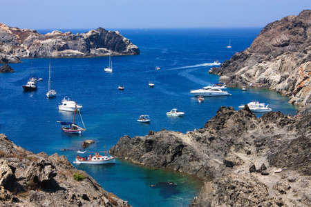 Boats on mediterranean bay. The Cap de Creus, a natural park, is ideal for excursions on foot or by boat. Situated in the northern Costa Brava, Girona province, Catalonia, Spain.