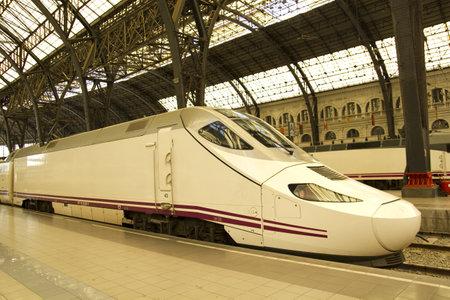 train station: Train at railway station, in Barcelona, Catalonia, Spain.