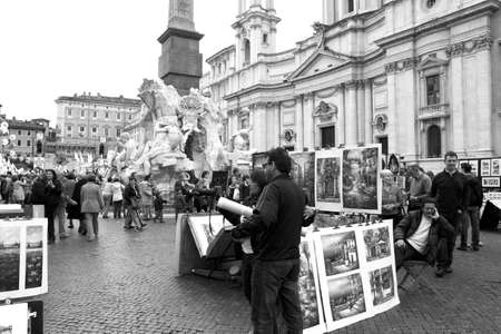 esp: Painters and tourists in Piazza Navona, Rome, Italy.   Photo taken on March, 13. 2011.   Rome, March 13. Painters & tourists in Piazza Navona on March 12, 2011, Rome, Italy.  The Piazza Navona is one of Romes most famous for his works of Baroque art, esp Editorial