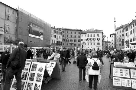 Painters and tourists in Piazza Navona, Rome, Italy.   Photo taken on March, 13. 2011.   Rome, March 13. Painters & tourists in Piazza Navona on March 12, 2011, Rome, Italy.  The Piazza Navona is one of Romes most famous for his works of Baroque art, esp