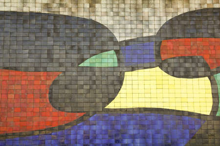 Mosaic Of Joan Miro, in the facade of Barcelona airport.BARCELONA, SPAIN - March 21: Mosaic Of Joan Miro, in the facade of Barcelona airport on March 21, 2011 in Barcelona. The piece measures 9 feet long by 5 high and was completed in 1970. Stock Photo - 10678711