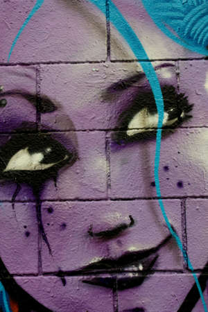 Lilac face. Drawing or Graffiti, made in a wall of Barcelona. Photo taken on: october 19, 2009 Stock Photo - 10678710