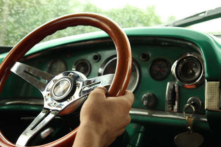 Driving a car. Hand driving a old car, close up, in Cuba Stock Photo