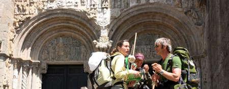 galicia: SANTIAGO DE COMPOSTELA, SPAIN - MAY 30: Pilgrims on the Camino de Santiago in the door Platerias after reaching Santiago de Compostela on May 30, 2009, in Santiago, Spain.