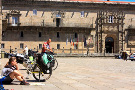 xacobeo: Cycling pilgrim on the Camino de Santiago in the square of Obradoiro after reaching Santiago de Compostela on May 30, 2009, in Santiago, Spain. Xacobeo year. Editorial