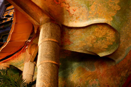Columns inside Casa Mila or La Pedrera. Painted ceiling. Catalan Modernism. Photo taken on: December 1, 2009, in Barcelona, Spain.