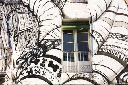 squatter: Facade of house painted, Barcelona, Spain. Photo taken on: December 11, 2009, in Barcelona, Spain. Editorial
