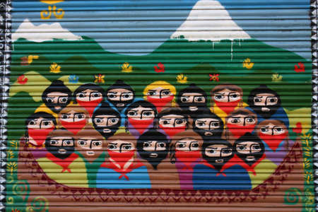 Mural on a metal fence, a tribute to the EZLN Zapatista guerrilla. Photo taken on: December 1, 2009, in Barcelona, Spain.
