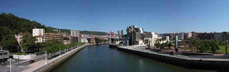 salve: Bilbao Nervion River as it passes by park, the University, the Guggenheim and bridge La Salve, Euskadi, Spain. Photo taken on: May 22nd, 2010, in Bilbao, Spain.