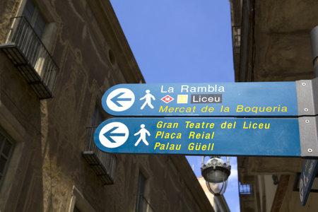 ramblas: Sign indicating the Ramblas, the Liceu Theatre metro and Boqueria Market, Barcelona. Catalonia, Spain.  Photo taken on  April 24, 2011 in Pi Street, Barcelona, Spain. Editorial