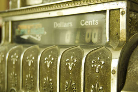 Cash register. Detail of an old cash register, charge in dollars. photo