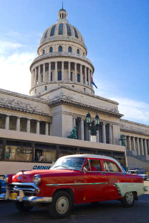 HAVANA, SEP 7: A vintage car circulating in front of the Capitol on September 23, 2011 in Havana, Cuba. Cubans, unable to buy newer models, keep thousands of them running.