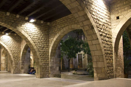 street lamps: Small corner arched Gothic Quarter of Barcelona.