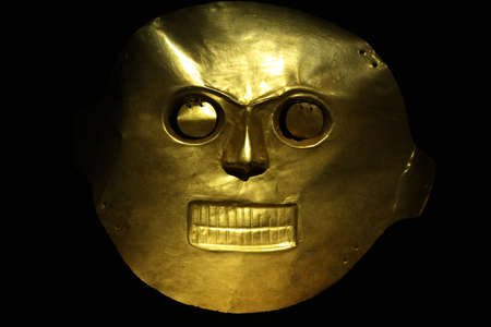 Golden mask in the Gold Museum, Bogota, Colombia. Tolima culture, Cauca Valley.