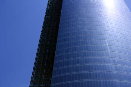 Modern office building. Facade of a modern office building, blue sky and the glare. Stock Photo - 11884968