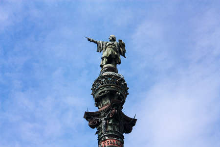 colonizer: Christopher Columbus statue, in port of Barcelona, symbol of city.