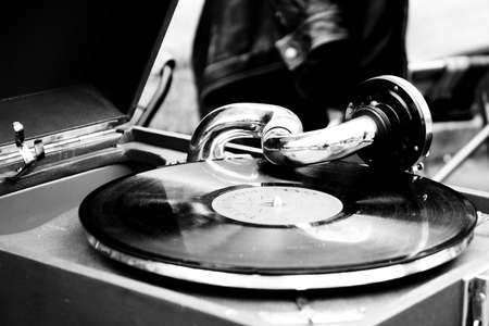 secondhand: Old record player in a market of second-hand objects. Monochrome photo. Stock Photo