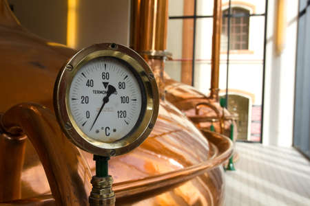 distillate: Temperature Gauge. Old style of brewing beer.