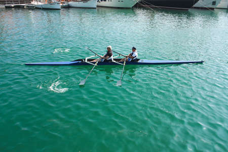 Two grandparents do water sports, on October 5, 2011 in Barcelona, Spain.