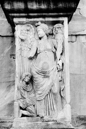italian architecture: Angel in the arch of Constantine, near to Coliseum. Century IV. Monochrome photography.