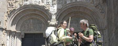 SANTIAGO DE COMPOSTELA, SPAIN - MAY 30: Pilgrims on the Camino de Santiago in the door Platerias after reaching Santiago de Compostela on May 30, 2009, in Santiago, Spain. Xacobeo year.