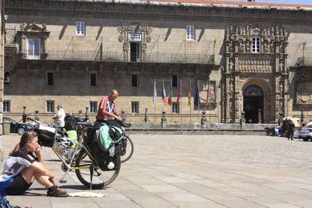 SANTIAGO DE COMPOSTELA, SPAIN - MAY 30: cycling pilgrim on the Camino de Santiago in the square of Obradoiro after reaching Santiago de Compostela on May 30, 2009, in Santiago, Spain. Xacobeo year.Santiago de Compostela, Spain
