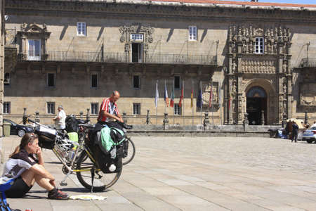 santiago: SANTIAGO DE COMPOSTELA, SPAIN - MAY 30: cycling pilgrim on the Camino de Santiago in the square of Obradoiro after reaching Santiago de Compostela on May 30, 2009, in Santiago, Spain. Xacobeo year.Santiago de Compostela, Spain Editorial