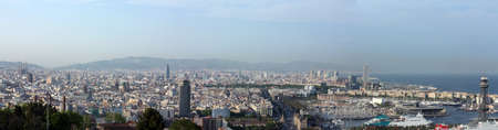 urban scenics: View of Barcelona from Montjuic Mountain  It shows the Holy Family Cathedral, Columbus statue, harbor, beach     Stock Photo