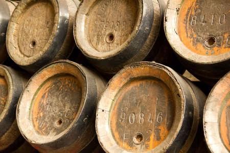 Row of wooden beer barrels. Nineteenth century. December 19, 2011 on Barcelona, Catalonia, Spain.  Stock Photo - 13575966