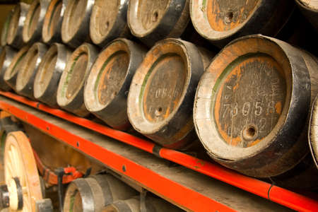 Row of wooden beer barrels. XIX century. December 19, 2011 on Barcelona, Catalonia, Spain.  Stock Photo - 13575959